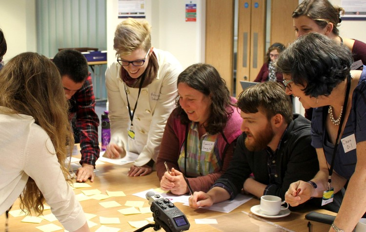 Members of the Energy Humanities research team guide players through a game of 'Perfect Storm! Feminist Energy Transition' at the 2018 Petrocultures conference in Scotland.