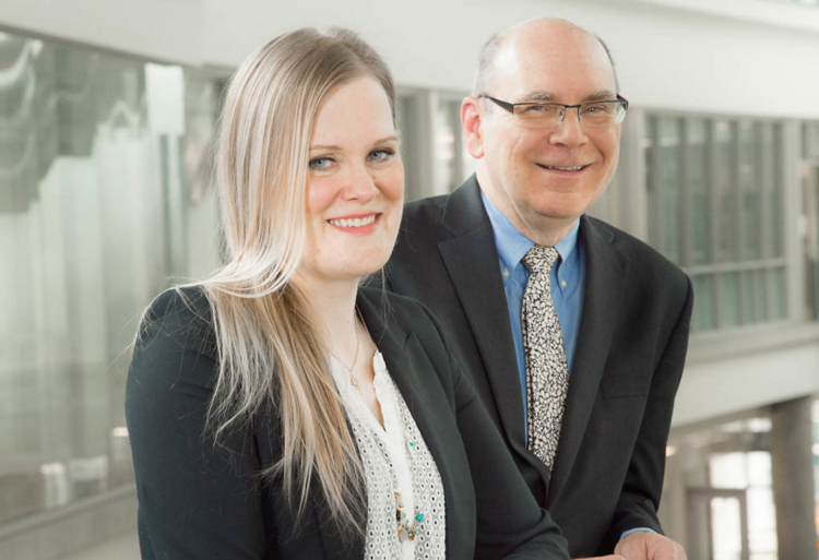 Research Services Office Contract Specialist Jennifer Morrison and Future Energy Systems Director Larry Kostiuk.