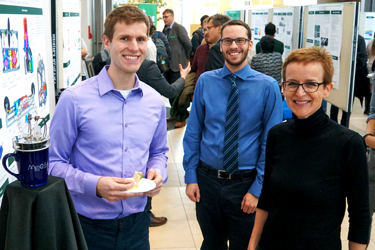 Solar theme leader and Principal Investigator Dr. Jillian Buriak meeting graduate students Connor Speer and Jason Michaud from the geothermal theme.